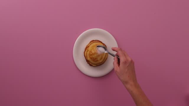 preparing pancakes, eggs, flour, baking powder, sugar, milk, dulce de leche, glass bowl - stacking stock videos & royalty-free footage