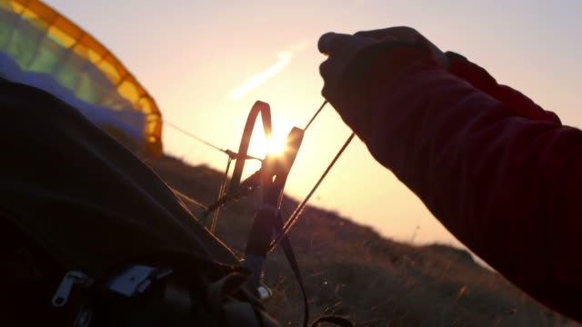 hd: preparing parachute before launching - paragliding stock videos & royalty-free footage