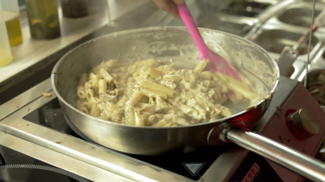 Preparing Pasta with Mushrooms, Herbs and Cheese