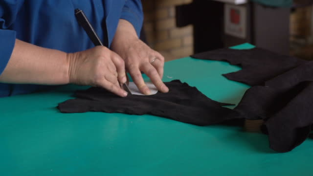 Preparing pieces of leather