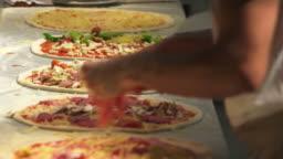 Preparing Pizzas Close-up