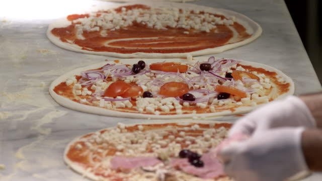 preparing pizzas in a restaurant - italian culture stock videos & royalty-free footage