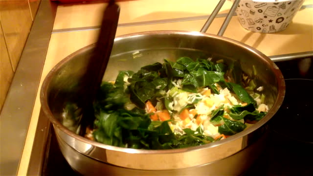 Preparing risotto with chard