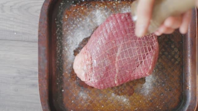 preparing roast beef joint on tray - roast beef stock videos & royalty-free footage