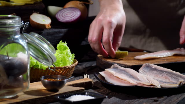 preparing rollmops - marinated stock videos and b-roll footage