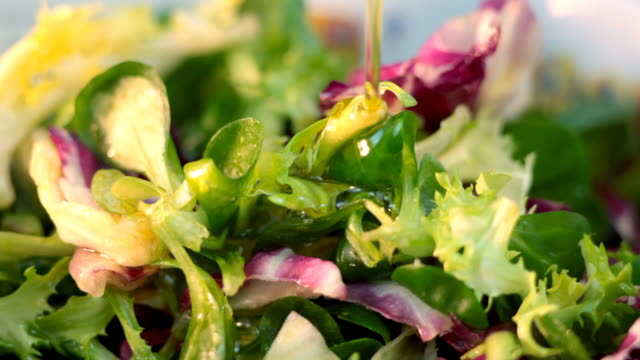 preparing salad - salad dressing stock videos & royalty-free footage