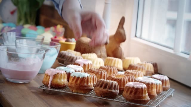 Preparing Small Easter Bunt Cakes with Icing
