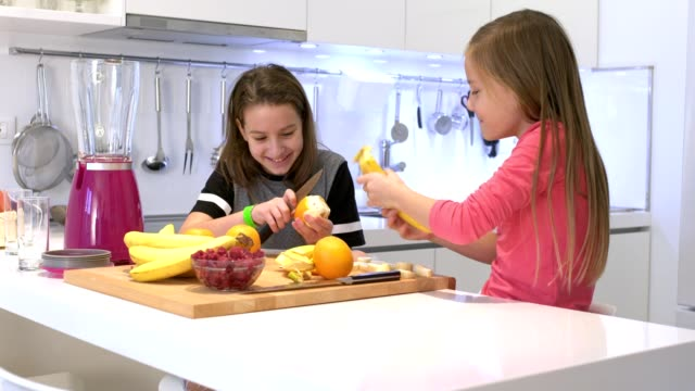 preparing smoothie together - smoothie stock videos and b-roll footage