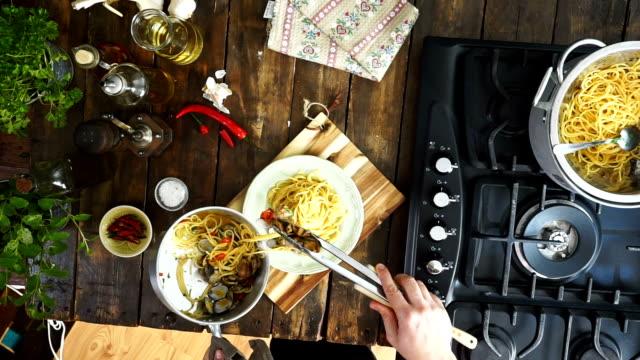 preparing spaghetti alla vongole - parsley stock videos and b-roll footage
