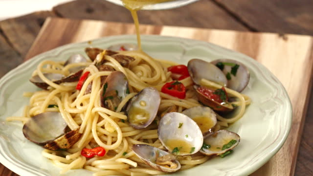 preparing spaghetti alla vongole - seafood stock videos & royalty-free footage