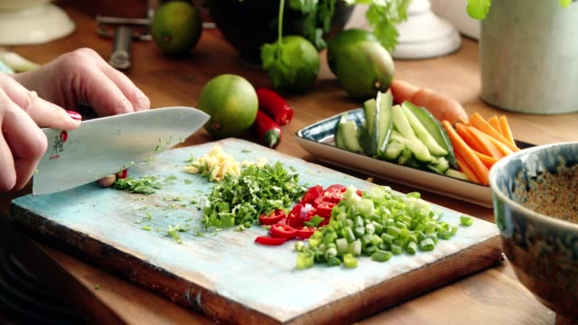 preparing spring rolls with vegetables and shrimps - chive stock videos & royalty-free footage
