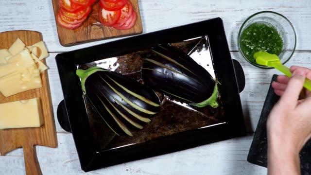 preparing stuffed eggplants - aubergine stock videos & royalty-free footage