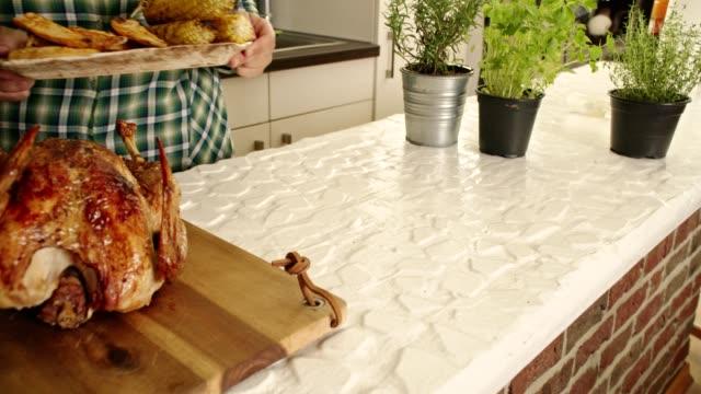 Preparing Stuffed Turkey for Thanksgiving Dinner