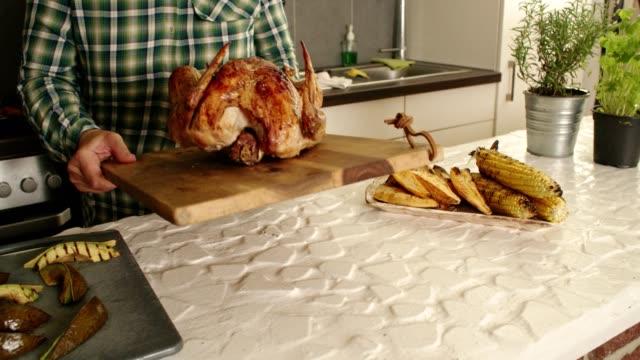 preparing stuffed turkey for thanksgiving dinner - roast turkey stock videos & royalty-free footage
