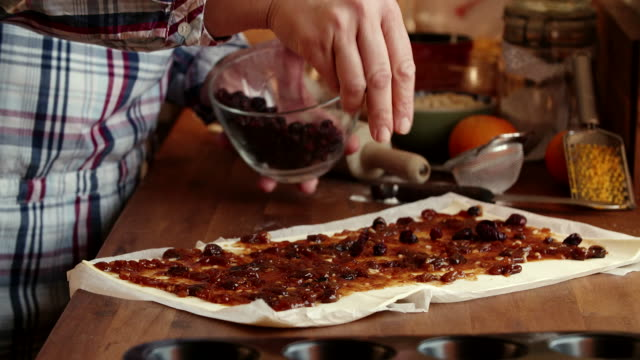 preparing sweet filo pastry mince pies with dried fruits - raisin stock videos & royalty-free footage