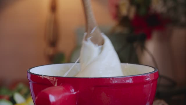 preparing swiss cheese fondue in a pot served with bread - fondue stock videos & royalty-free footage