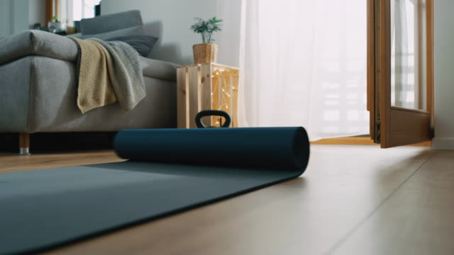 slo mo preparing the exercise mat for exercising at home - exercise equipment stock videos & royalty-free footage