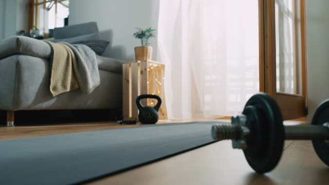 slo mo preparing the exercise mat in the living room - exercise room stock videos & royalty-free footage