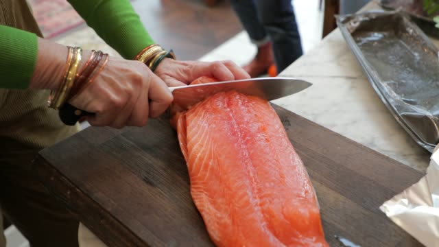 preparing the salmon - salmon stock videos & royalty-free footage