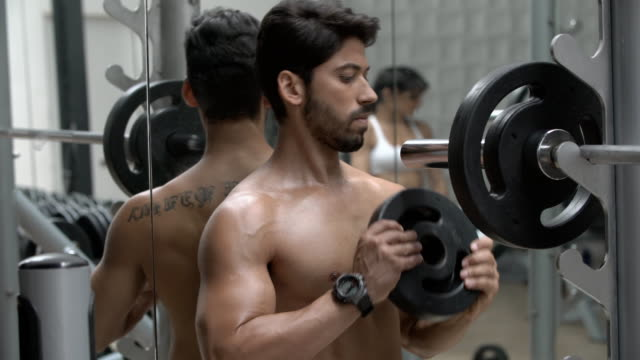 preparing to exercise at the gym - shirtless stock videos & royalty-free footage