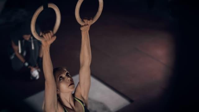preparing to exercising on gym rings - gymnastic rings stock videos & royalty-free footage