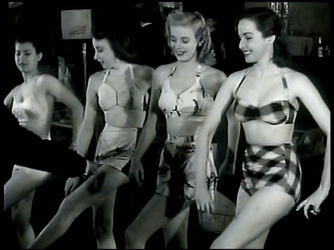 preparing to open lew brice's 800 club: woman trying on gown lew brice showing four women dance steps routine. man holding match to curtains... - 800 metre stock videos & royalty-free footage