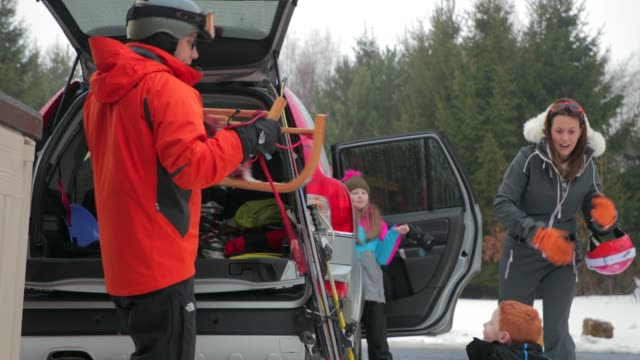preparing to ski with his family - ski goggles stock videos & royalty-free footage