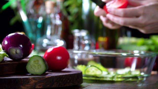 preparing tomato and cucumber salad - tomato salad stock videos & royalty-free footage