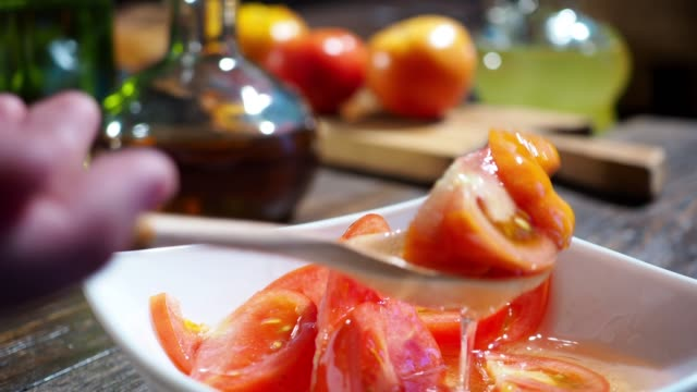 preparing tomato salad - salad dressing stock videos & royalty-free footage