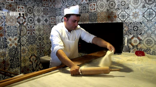 hd: preparing traditional turkish pastry called as pide - rolling pin stock videos & royalty-free footage