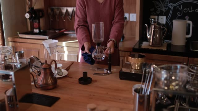 preparing utensils for making coffee - one mature woman only stock videos & royalty-free footage