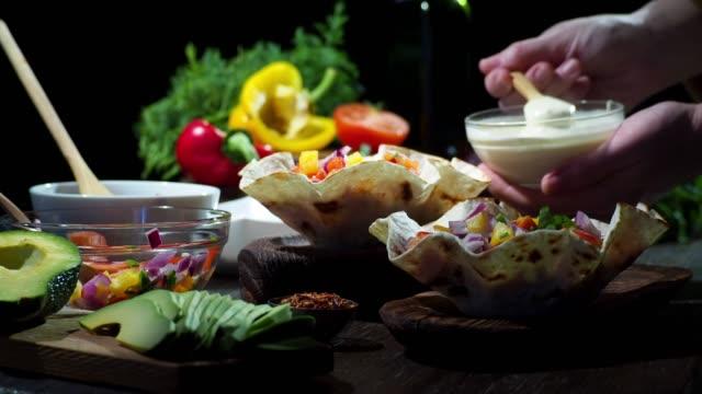 Preparing vegan taco salad