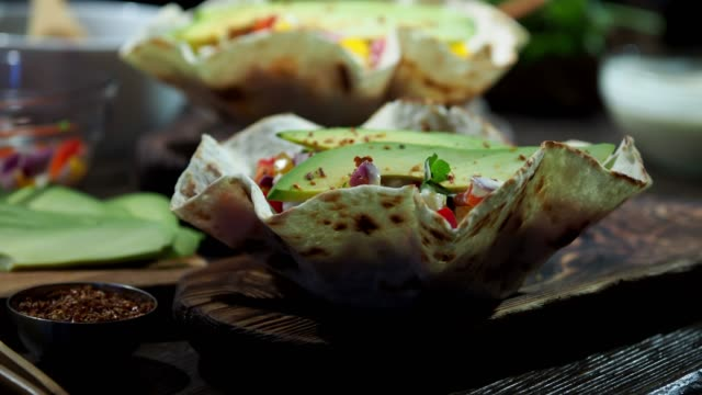 preparing vegan taco salad - tortilla flatbread stock videos & royalty-free footage
