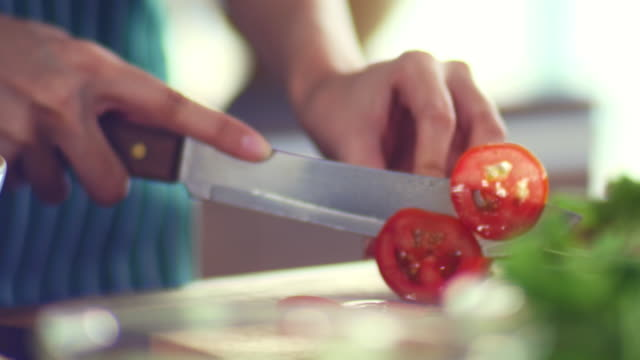 preparing vegetable : cutting tomato - chopping stock videos & royalty-free footage