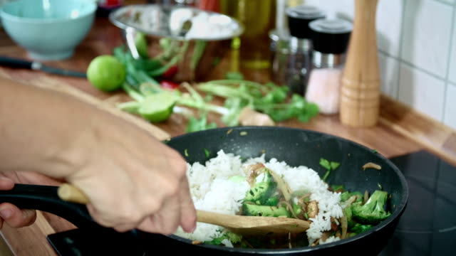 Preparing Vegetables and Chicken in a Wok for Nasi Goreng