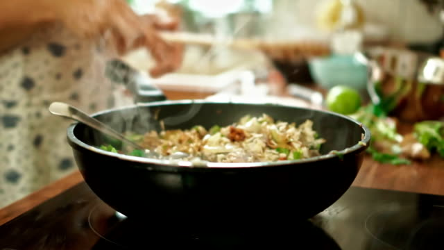 preparing vegetables and chicken in a wok for nasi goreng - fried rice stock videos and b-roll footage