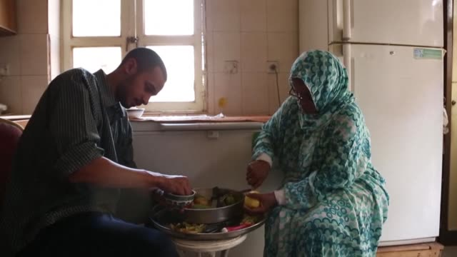 preparing vegetables in a quiet khartoum neighbourhood pharmacist omer eltigani hopes not just to serve up the dish an aunt is teaching him but also... - aunt stock videos & royalty-free footage
