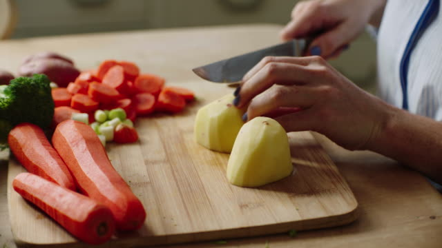 preparing vegetables - chopping stock videos & royalty-free footage