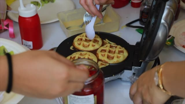 preparing waffles - waffle iron stock videos and b-roll footage