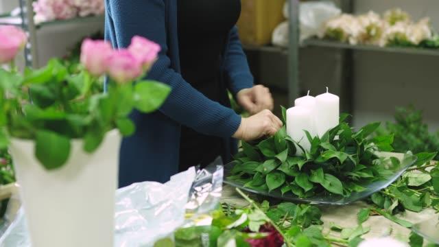 preparing wedding decoration - flower arrangement stock videos & royalty-free footage
