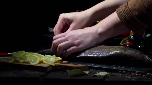 preparing whole salmon for baking - condiments stock videos and b-roll footage