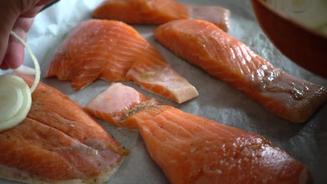 preperation of baked salmon fish - filleted stock videos & royalty-free footage