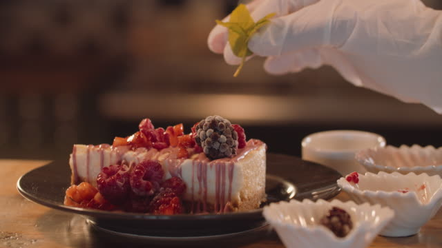prepering cheese cake with delicious melted ruby chocolate - preparation stock videos & royalty-free footage