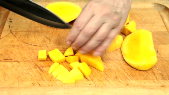 prepping a mango (last part of 5) - mango stock videos and b-roll footage