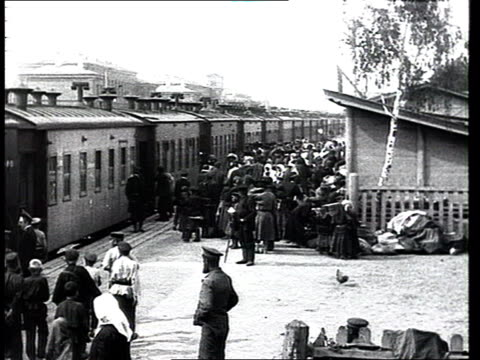 prerevolutionary imperial russia people travelling or refugees migrating crowds of people in a train station get in wagons of a passengers train - railway station platform stock videos and b-roll footage