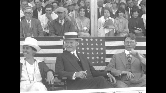 pres calvin coolidge and first lady grace coolidge sitting in box people sitting in stands behind them / line of people leading cattle into outdoor... - south dakota stock-videos und b-roll-filmmaterial