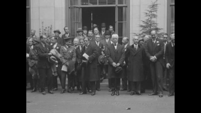 pres calvin coolidge and presidential secretary everett sanders step outside of building and pose for photo opportunity as reporters come out of door... - coolidge calvin stock videos & royalty-free footage
