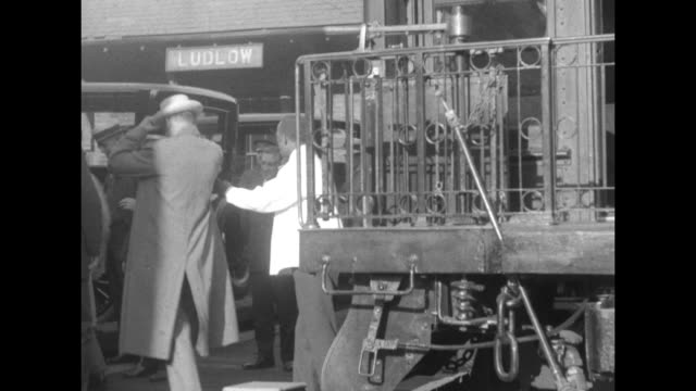 pres calvin coolidge raises straw hat from rear platform of his train with wife grace and son john they disembark at ludlow station and enter a... - 1924 stock videos and b-roll footage