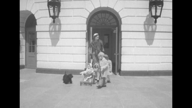pres. dwight eisenhower's daughter-in-law barbara jean eisenhower and her three children coming out of door of white house along with their dog,... - us president stock videos & royalty-free footage