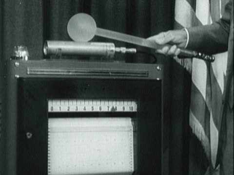 pres. eisenhower uses wand to trigger relay / pres. eisenhower addressing the general assembly at the u.n. - 1957 stock-videos und b-roll-filmmaterial
